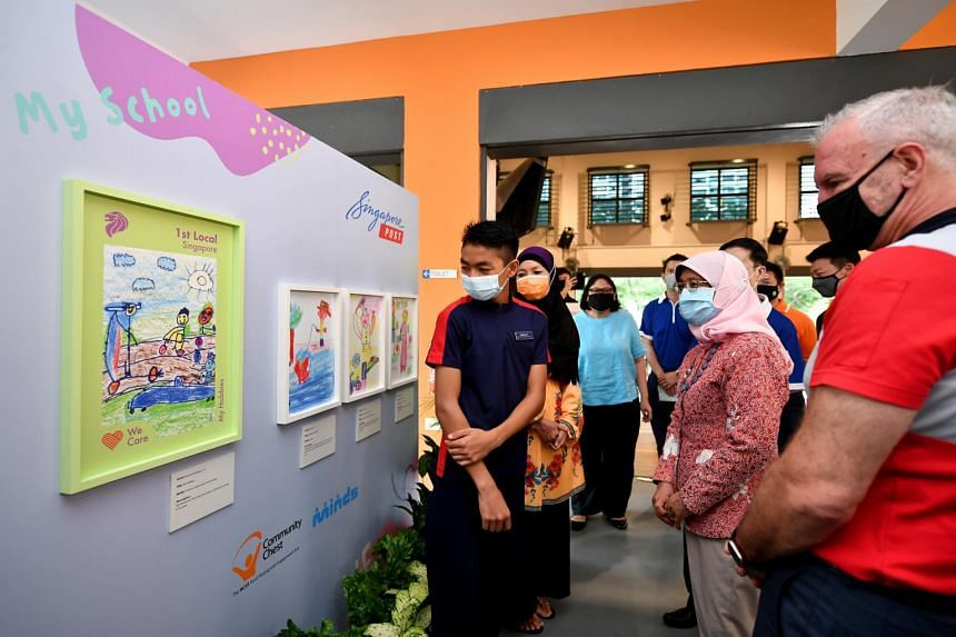 Madam Halimah Yacob (second from right) looking at the winning artwork at Minds Fernvale Gardens School on Nov 13, 2020.