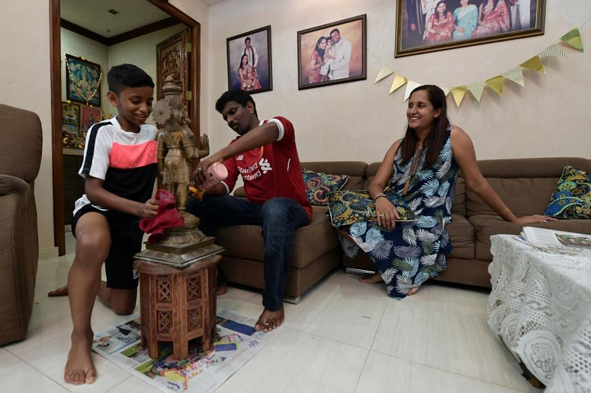 Mr Thamil Selvan V.T. Govintharaju, his wife Ms Darshini Radha Krishnan, and their son Krishav Ram Thamil Selvan.