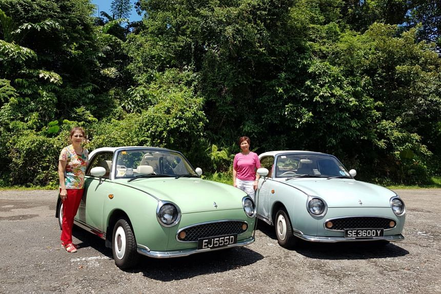 Lina Yew and her sister Yew Lei May (right) posing with their respective Nissan Figaro.