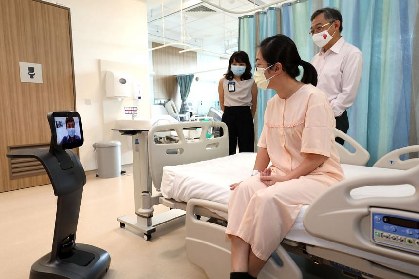 Health Minister Gan Kim Yong (right) viewing a demonstration of the facilities at Outram Community Hospital on Nov 13, 2020.