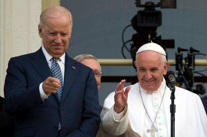 A 2015 photo shows Biden (left) with Pope Francis on a balcony at the US Capitol in Washington.