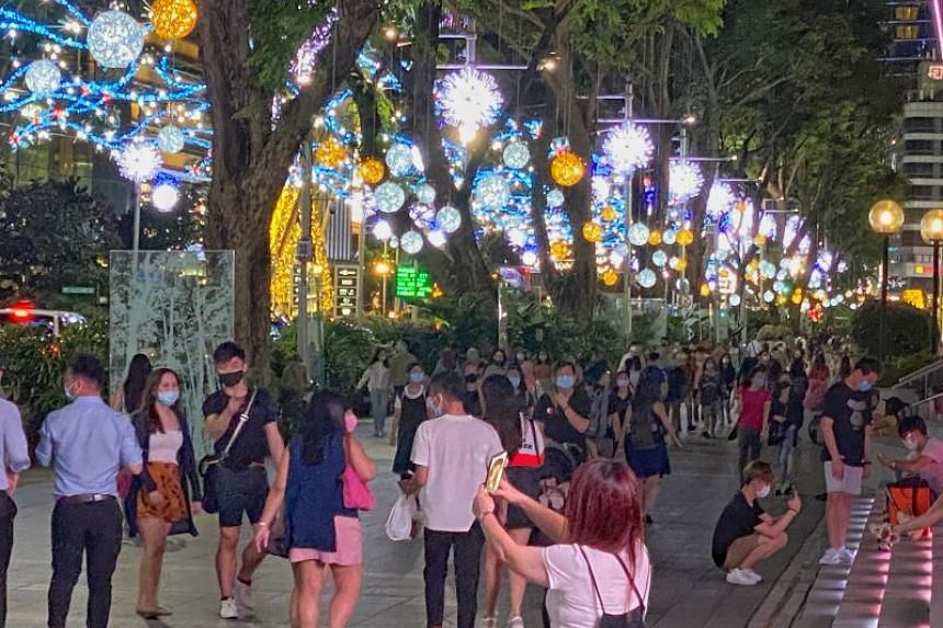 Orchard Road is decked out with snow flakes, mistletoe and holly decorations.