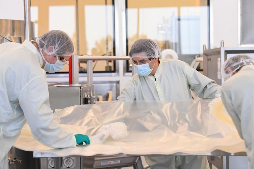 Scientists working inside the CSL Biotech facility after CSL announced it had agreed to develop the Covid-19 vaccine.