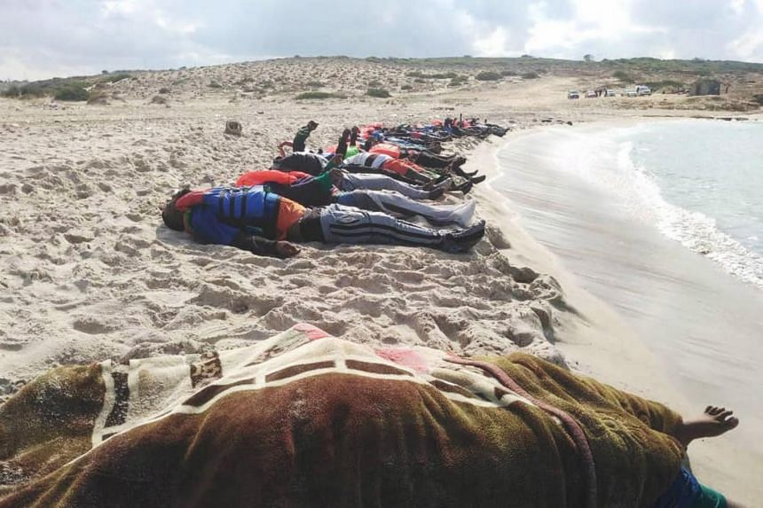 Washed bodies of migrants that died at sea, on the coast of Alkhoms in Libya, on Nov 12, 2020.