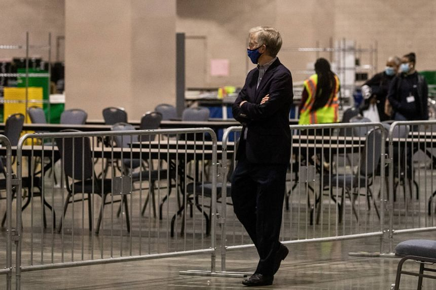 A man watches on from the observers area as election workers count ballots at the Philadelphia Convention Centre on Nov 6, 2020.