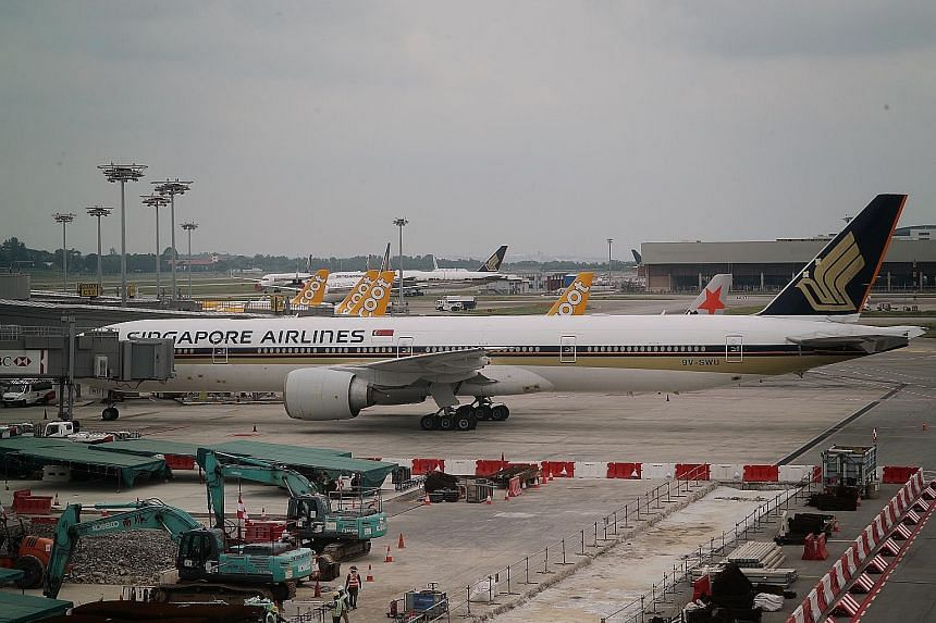 Singapore Airlines, whose convertible bond issue received strong interest from institutional investors, said yesterday that the offer was more than four times oversubscribed. ST PHOTO: JASON QUAH