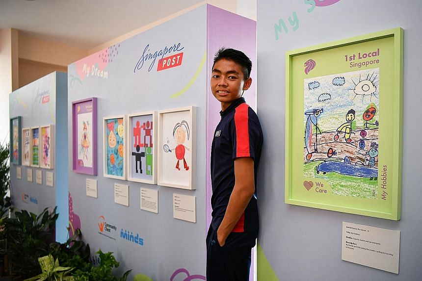 Student Diman Mamat, 14, from Minds Lee Kong Chian Gardens School, with his winning design (in green frame beside him), based on the theme My Hobbies. All proceeds from the sale of the stamps will go to charity.