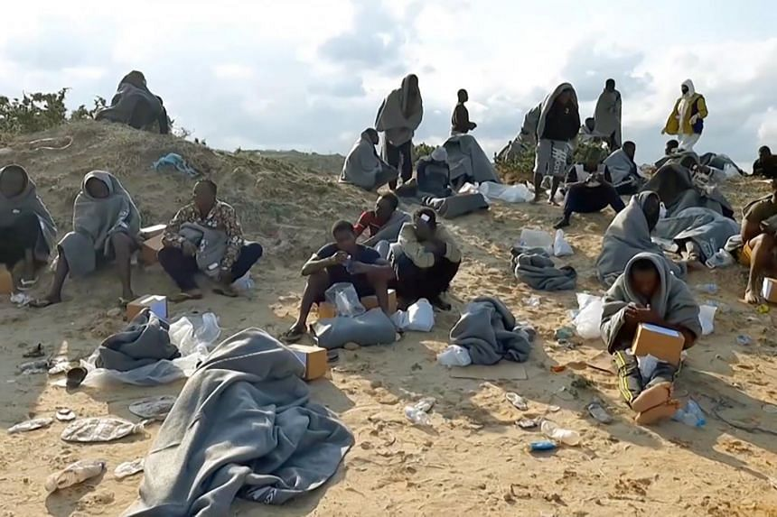 Migrants, who survived a deadly shipwreck, on the coast of al-Khums, Libya, on Nov 12, 2020.