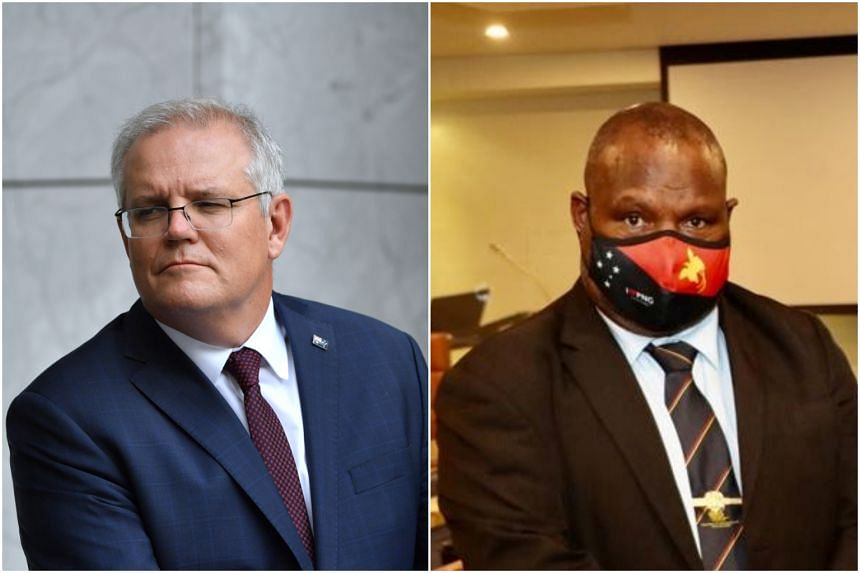 Australian Prime Minister Scott Morrison (left) agreed to delay the trip after a request from Papua New Guinea Prime Minister James Marape.