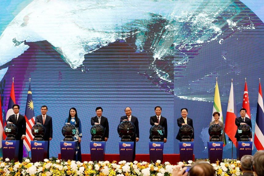 Vietnam's Prime Minister Nguyen Xuan Phuc (centre) and other leaders attend the launching ceremony of the Asean Smart Logistics Network in Hanoi on Nov 14, 2020.