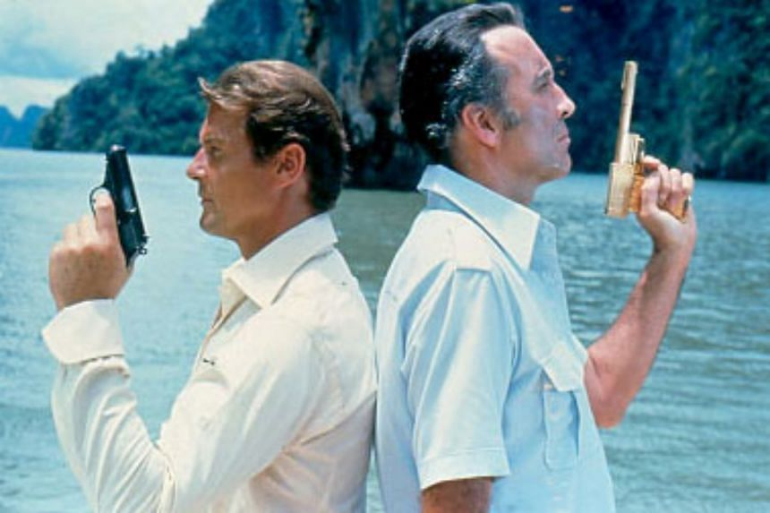 The Man With The Golden Gun starred Roger Moore (left) as James Bond and Christopher Lee as assassin Francisco Scaramanga.