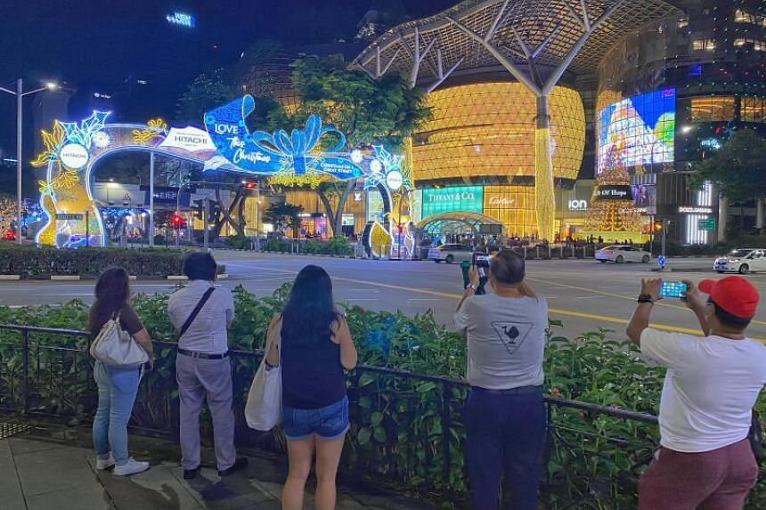 People take pictures of the Christmas Light-up at Orchard Road, on Nov 13, 2020.