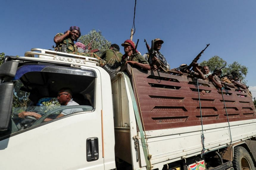 Members of Amhara region militias ride on their truck as they head to face the Tigray People's Liberation Front, in Sanja, Amhara region near a border with Tigray, Ethiopia, on Nov 9, 2020.