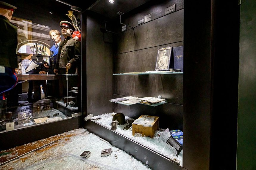 Broken glass and ransacked shelves are seen in the Eyewitness War Museum in Beek, the Netherlands, following a burglary on Aug 4, 2020.