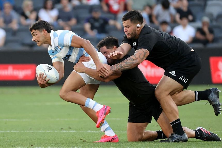 New Zealand's Anton Lienert-Brown (centre) and Tyrel Lomax tackling Argentina's Santiago Carreras during their Tri-Nations match on Nov 14, 2020.