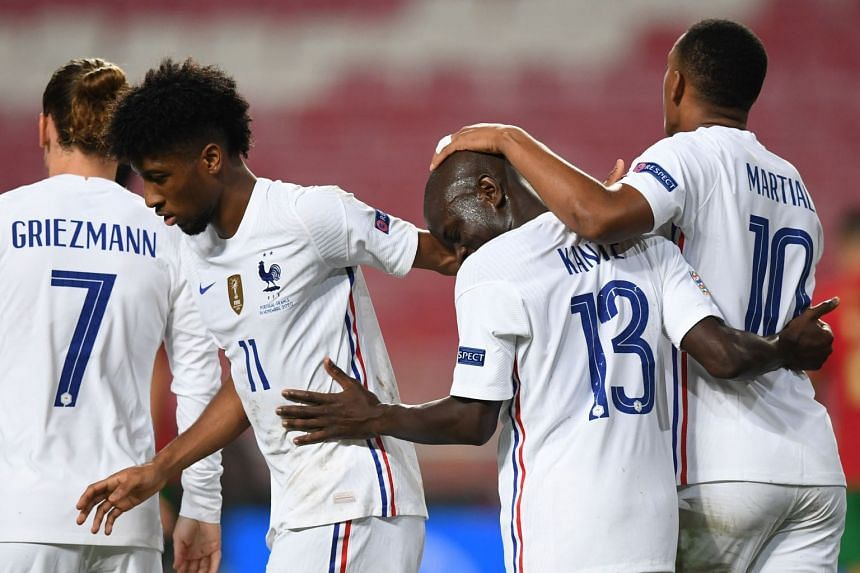 Kante (second right)) celebrates his goal with teammates.
