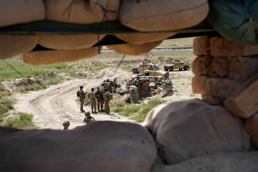 A 2019 photo shows US troops through a firing position at an Afghan National Army checkpoint.