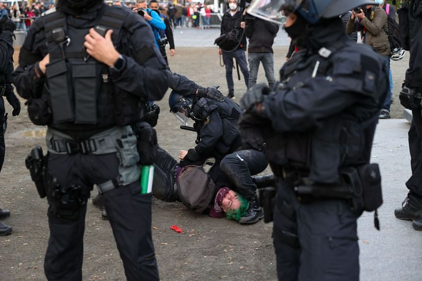 A protester is detained by police during a demonstration in Frankfurt am Main, Germany.