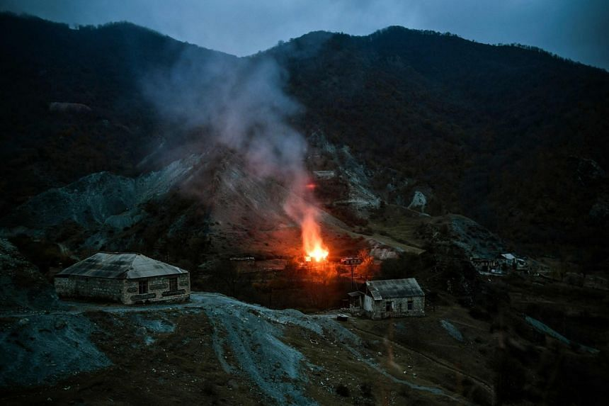 A house burns in a village outside the town of Kalbajar, on Nov 14, 2020.