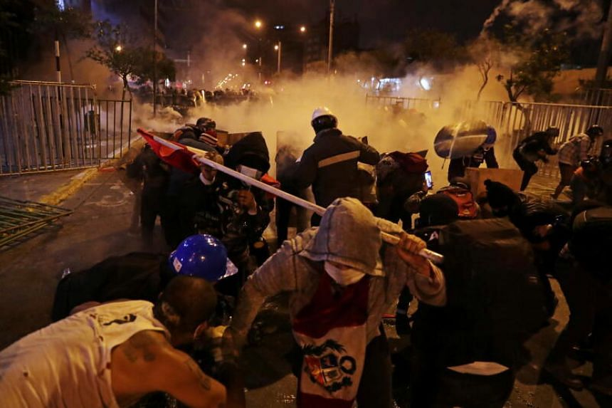 Demonstrators clashing with police during a protest in Lima, Peru, on Nov 14, 2020.