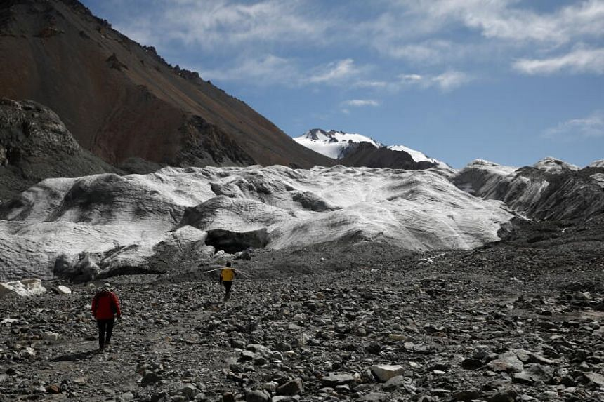 Dr Qin Xiang and PhD student Jin Zizhen walking towards the Laohugou No. 12 glacier, which has seen melting accelerating in recent years.