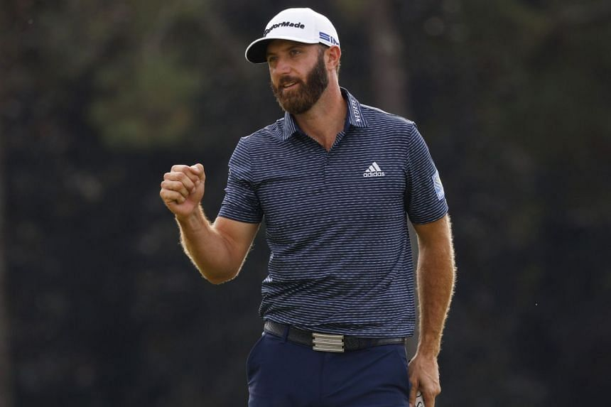 Dustin Johnson celebrates on the 18th green after winning The Masters, on Nov 15, 2020.