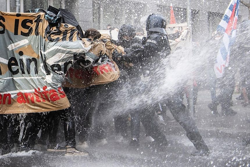 German police using a water cannon to disperse anti-lockdown protesters in Frankfurt city on Saturday after they were found to be not observing social distancing rules.