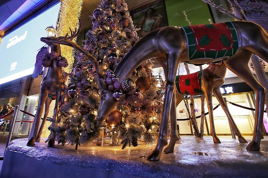The decorations may have been scaled down, but malls show the Christmas spirit is still alive in Orchard Road with touches such as the huge Christmas tree outside Paragon (left), the lights outside Orchard Central (below, left) and the reindeer sculp