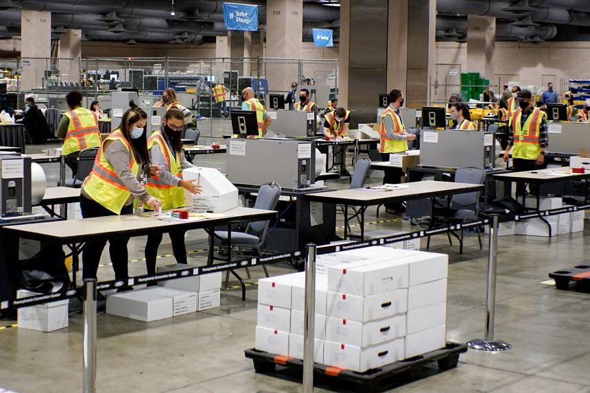 Electoral workers count ballots during the 2020 US presidential election in Philadelphia, Pennsylvania on Nov 3.