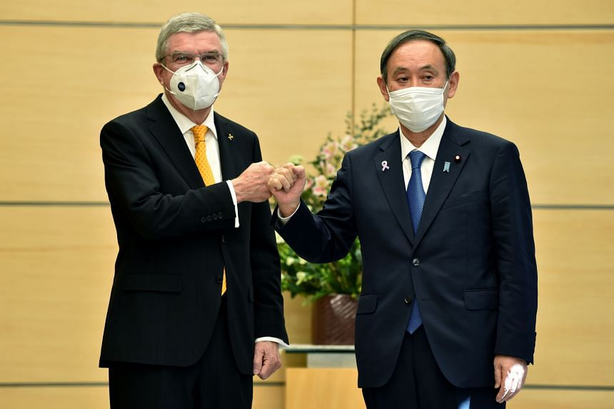 International Olympic Committee president Thomas Bach and Japan's Prime Minister Yoshihide Suga in Tokyo on Nov 16, 2020.