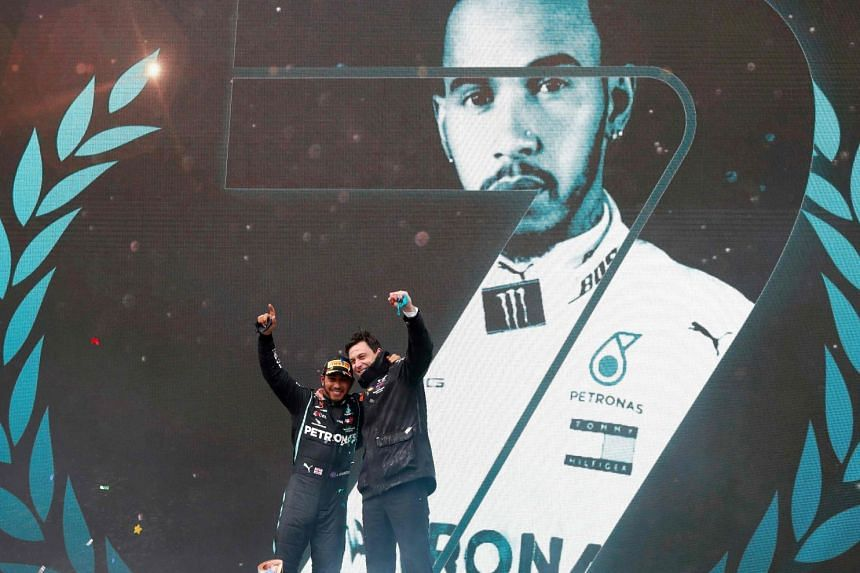 Lewis Hamilton and Mercedes team principal Toto Wolff on the podium after the Briton won the F1 Turkish Grand Prix in Istanbul on Nov 15, 2020 to confirm a seventh drivers' title.