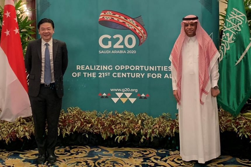 Second Minister for Finance Lawrence Wong (left) with Ambassador Saad Saleh Al-Saleh at the Commemorative Event for Saudi G-20 Presidency.