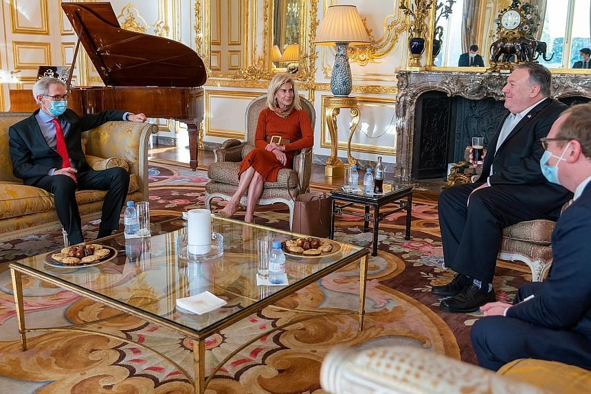 A handout photo from the US State Department showing Mr Mike Pompeo (second from right) and Ms Jamie McCourt, US ambassador to France, at the Institut Montaigne in Paris last Saturday. PHOTO: EPA-EFE