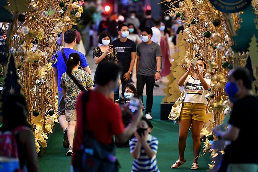 People out and about near Orchard Central last Saturday, enjoying the Christmas decorations. Yesterday marked the sixth day in a row that all new infections were imported, with no community cases and no cases from workers' dormitories.