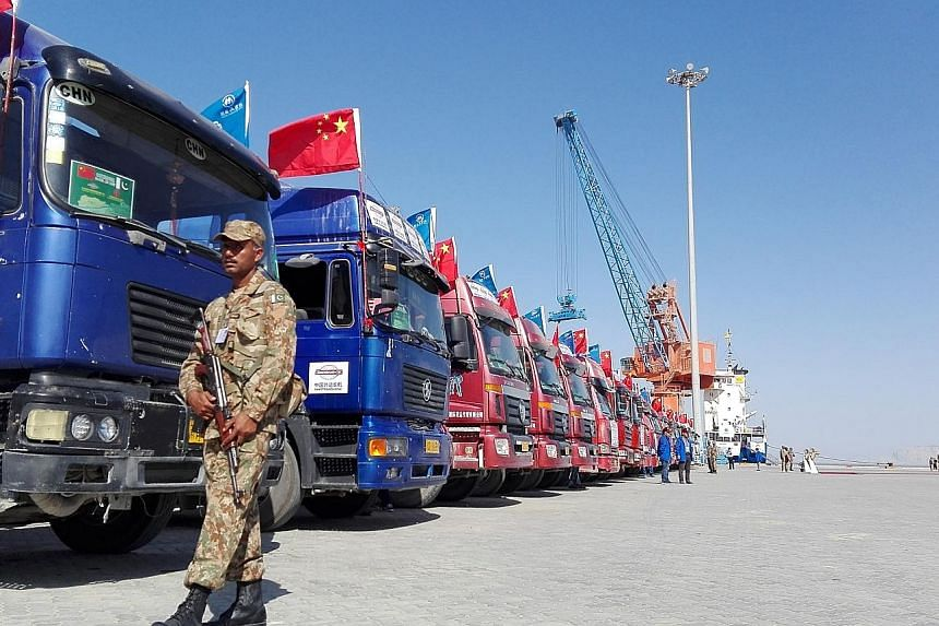 A 2016 photo of Chinese trucks parked at Pakistan's Gwadar port. Gwadar is strategically important because of its closeness to the Strait of Hormuz, the cross junction of vital international shipping routes.