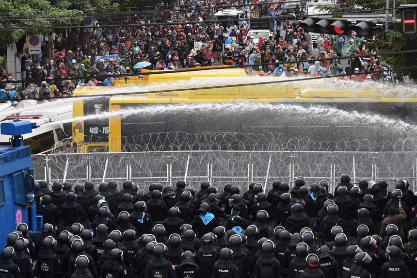 Police use water cannons to disperse pro-democracy protesters during a rally in Bangkok on Nov 17, 2020.