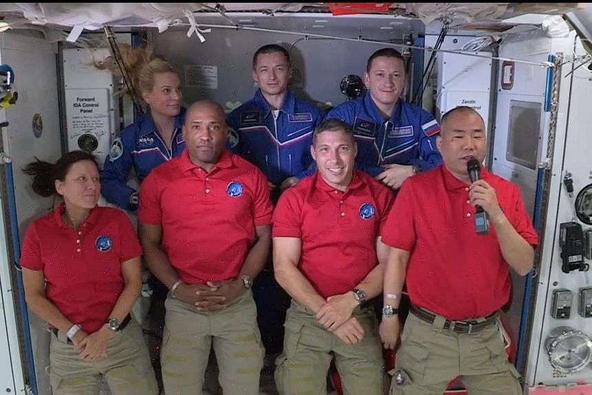 The crew members of the SpaceX Crew Dragon (front row, from left) Shannon Walker, Victor Glover, Mike Hopkins and Soichi Noguchi on board the ISS with astronauts (back row from left) Kate Rubins, Sergey Ryzhikov and Sergey Kud-Sverchkov.