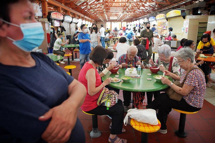 Diners eating at Maxwell food centre on Nov 17, 2020. The report by the Unesco evaluation body said hawker culture provides a sense of identity and continuity for people in Singapore.