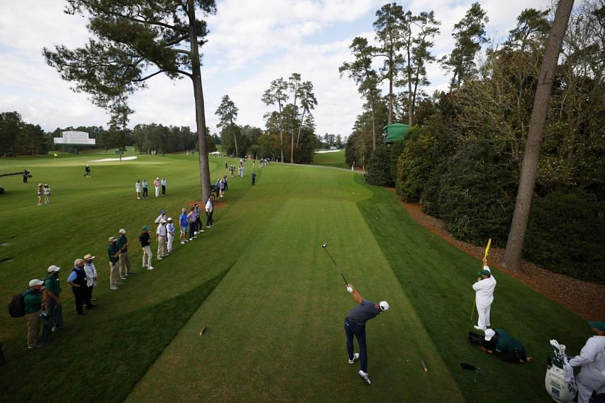 Dustin Johnson hits his tee shot on the 18th hole during the final round of The Masters on Nov 15.