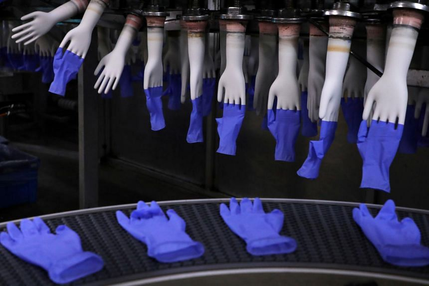 Roughly 15 per cent of Top Glove's total factory workforce will be affected by the two-week curbs.