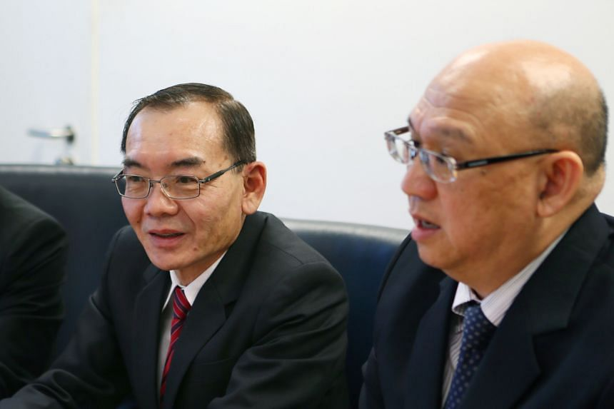 Starburst Holdings executive chairman Edward Lim (left) and managing director Yap Tin Foo, seen in a 2014 file photo, were interviewed by the CPIB last Thursday in connection with Starburst Engineering.