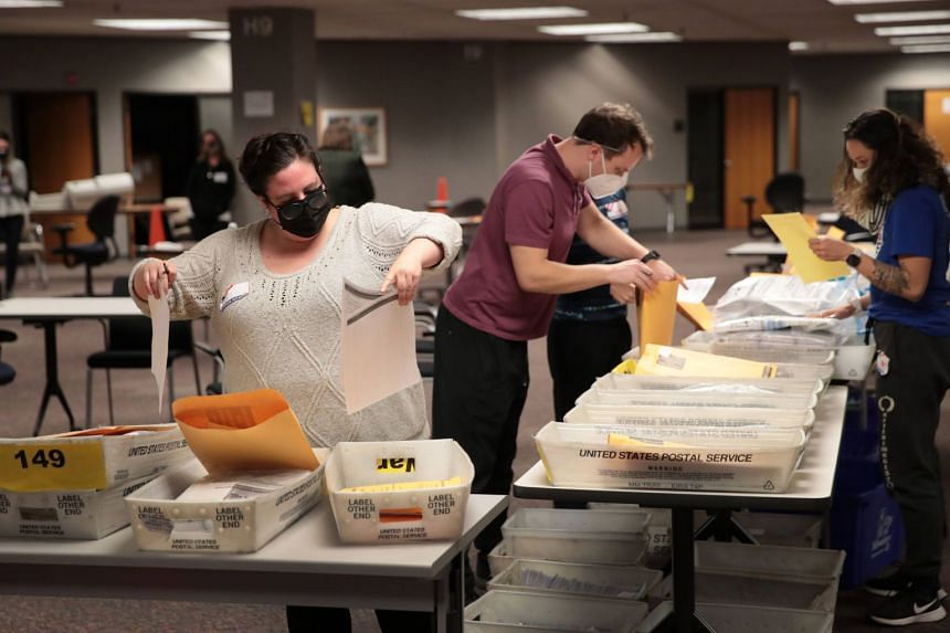 Election officials count absentee ballots in Milwaukee, Wisconsin, on Nov 4, 2020.