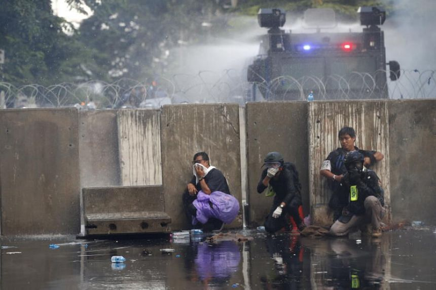 Pro-democracy protesters from police during a demonstration in Bangkok on Nov 17, 2020.