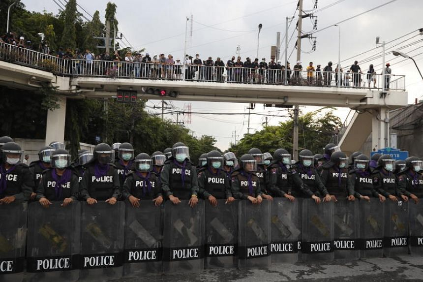 Riot police stand guard to disperse pro-democracy protesters in Bangkok on Nov 17, 2020.