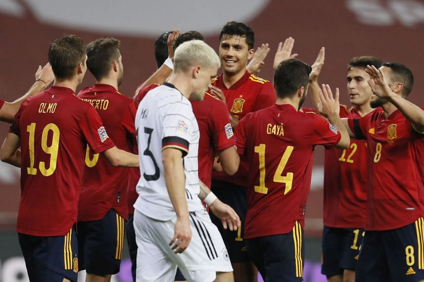 Spain's players celebrate their fourth goal against Germany.