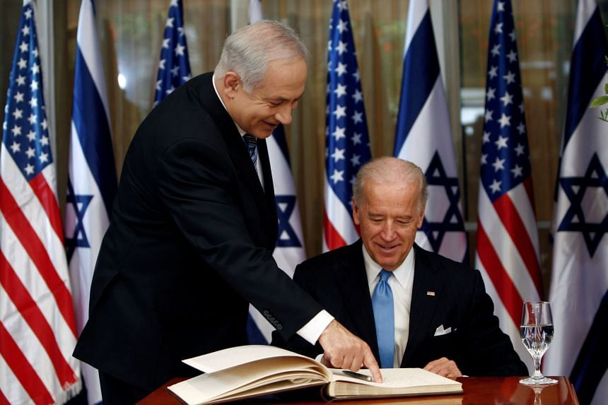 A 2010 photo shows Biden (seated) signing the guest book at Netanyahu's residence in Jerusalem before a meeting.