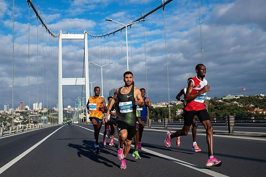Participants crossing the Bosphorus Bridge in the annual Istanbul Marathon earlier this month. Sports psychologists and elite endurance athletes advise people to create small milestones en route to a big goal in their quest to build mental fortitude.