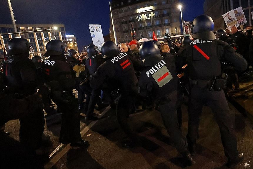 Protesters scuffling with police in Leipzig on Nov 7 at a rally against the German government's coronavirus restrictions. The number of uprisings globally has been increasing by an average of 11.5 per cent a year since 2009. PHOTO: REUTERS