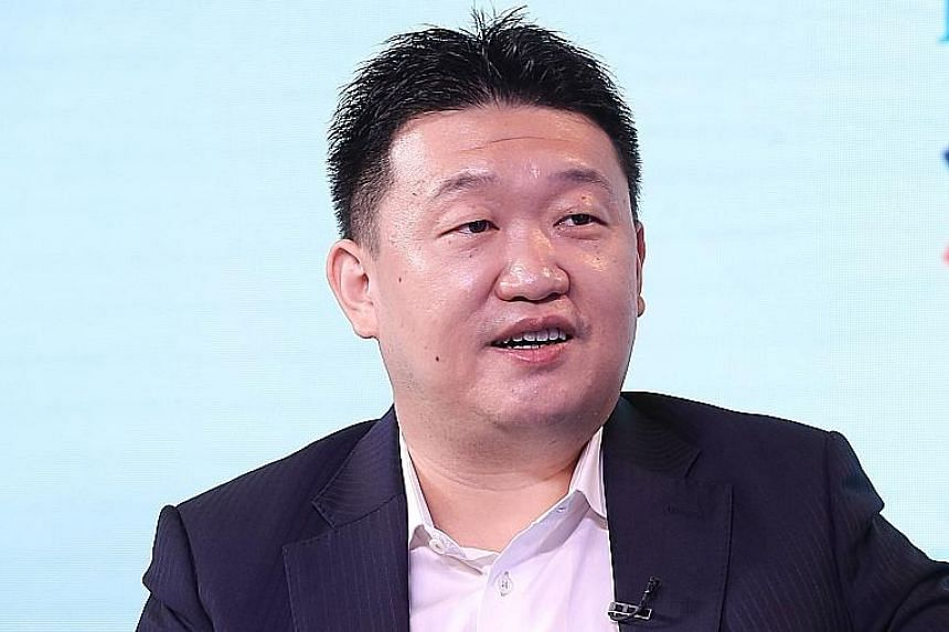Sea chief executive officer Forrest Li's net worth is estimated at US$9.8 billion (S$13 billion), according to the Bloomberg Billionaries Index. ST FILE PHOTO