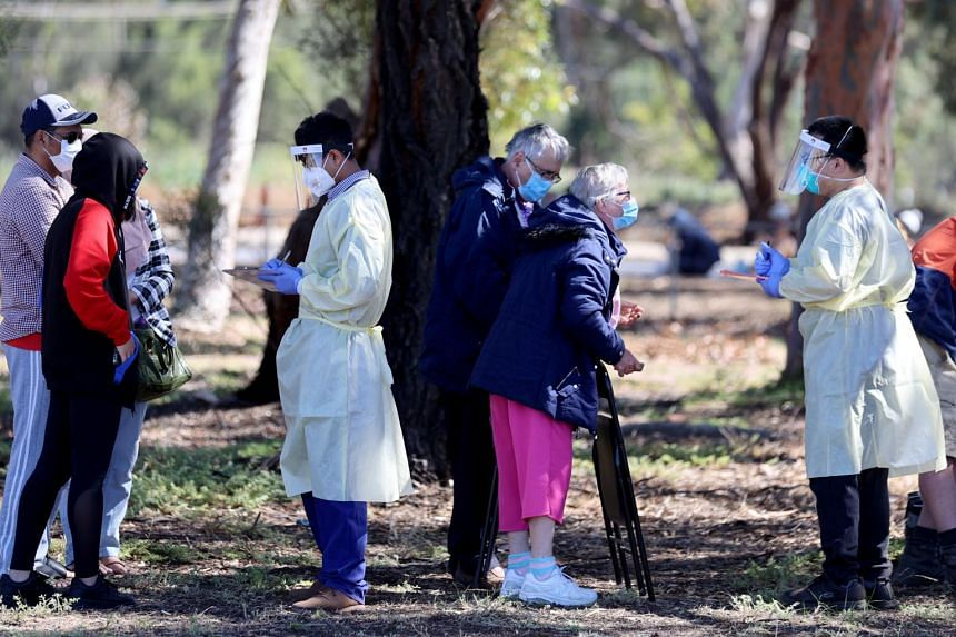 Medical staff take details from people queueing at a Covid-19 testing site in Adelaide on Nov 17, 2020.
